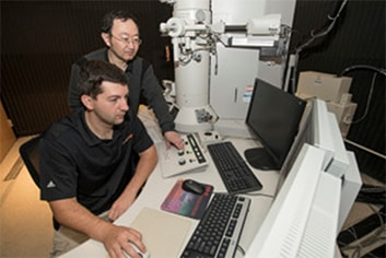 Brandt Ruszkiewicz (left) said he will have more time to work on electron microscopes after winning this year's Hitachi High Technologies Electron Microscopy Annual Fellowship.
